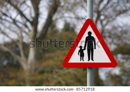 Red and white parent and child road safety sign - stock photo