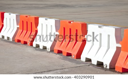 Red and white plastic barriers blocking the road - stock photo