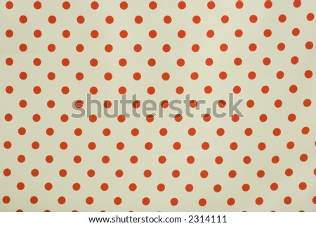 Red and white polka dot fabric background - stock photo