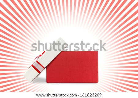 red and white present wrap by ribbon on bright background with clipping path. - stock photo
