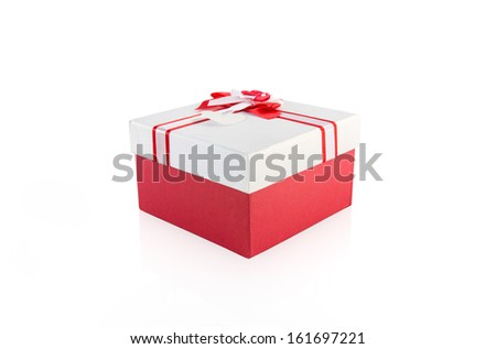 red and white present wrap by ribbon on white background with clipping path. - stock photo