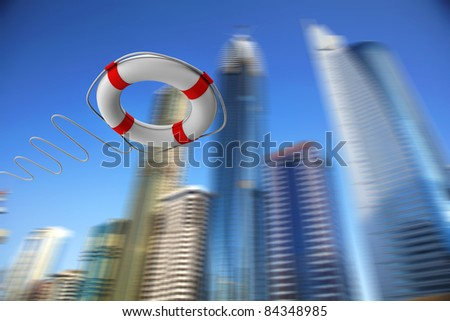 Red and white rescue ring against skyscrapers - stock photo