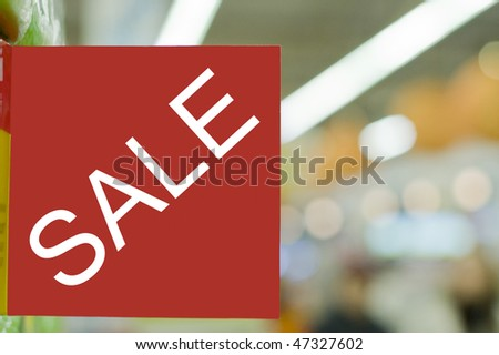 red and white sale sign indicating a discount in supermarket - stock photo
