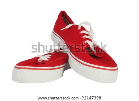 Red and white sneakers isolated on black with clipping path - stock photo