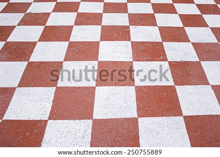 Red and white squares on urban land, symbol - stock photo