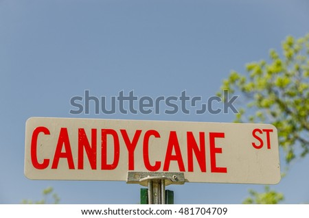 Red and white street sign for Candy Cane St