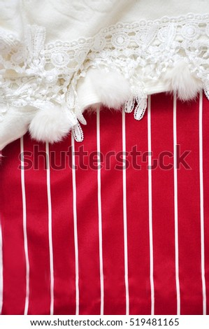 Red and white stripe background for copyspace decorated with white fabric