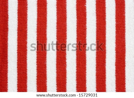red and white striped fabric - plain knitting - stock photo