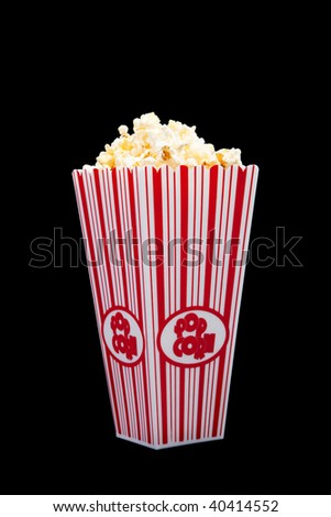 Red and white striped popcorn container on a black background - stock photo