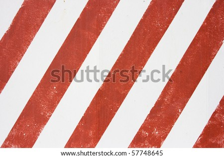 Red and white stripes of color on a wall - stock photo