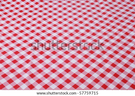 Red and white tablecloth - stock photo
