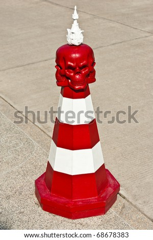 Red and White Traffic Cone with Red Skull - stock photo