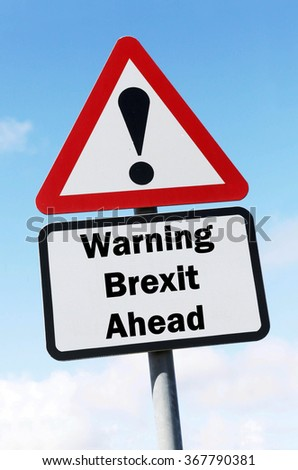 Red and white triangular road sign with a Brexit Warning Ahead concept against a partly cloudy sky background
