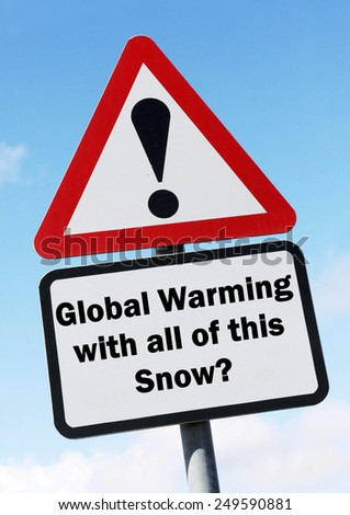 Red and white triangular road sign with a Global Warming with all of this Snow Question  concept against a partly cloudy sky background - stock photo
