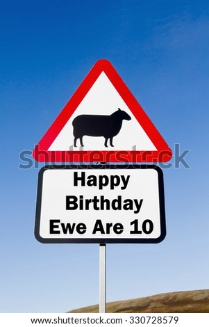 Red and white triangular road sign with a Happy Birthday Ewe Are 10 play on words concept against a partly cloudy sky background