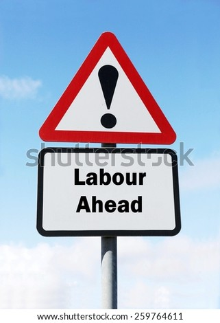 Red and white triangular road sign with a Labour Party ahead concept against a partly cloudy sky background