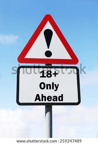 Red and white triangular road sign with a warning of an 18+ Zone ahead concept against a partly cloudy sky background - stock photo