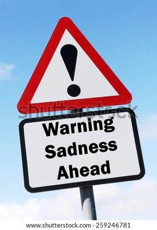 Red and white triangular road sign with a warning of Sadness ahead concept against a partly cloudy sky background - stock photo