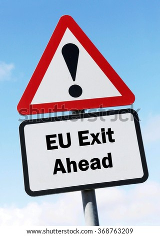Red and white triangular road sign with an EU Exit Ahead concept against a partly cloudy sky background - stock photo