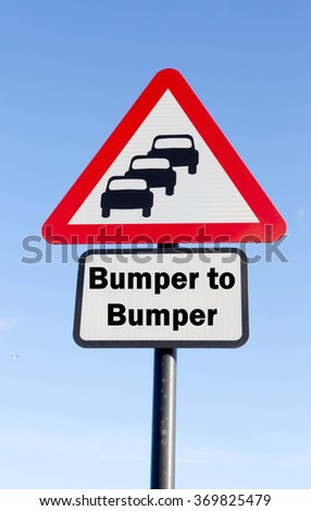 Red and white triangular road sign with Join a Bumper to Bumper Ahead concept against a partly cloudy sky background - stock photo