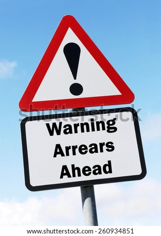 Red and white triangular road sign with warning of Arrears ahead concept against a partly cloudy sky background - stock photo