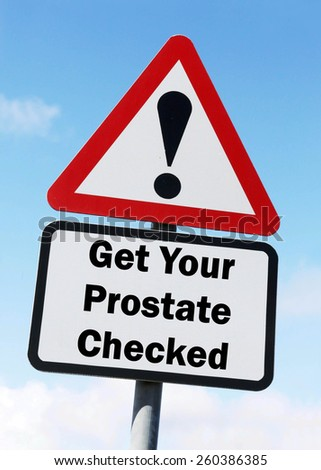 Red and white triangular road sign with warning to Get Your Prostate Checked ahead concept against a partly cloudy sky background - stock photo