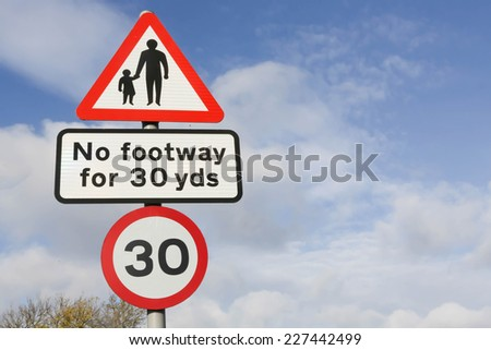 Red and white triangular warning road sign indicating pedestrian walkway, no footway for 30 yards. - stock photo
