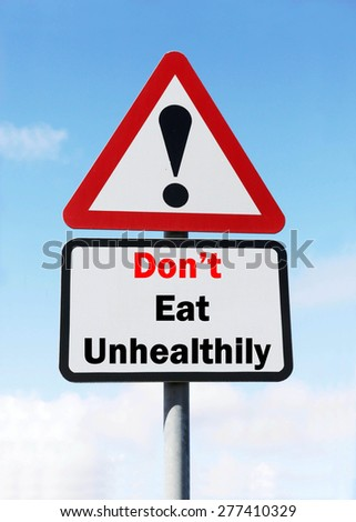 Red and White triangular warning road sign with a Don't Eat Unhealthily concept against a partly cloudy sky background. - stock photo