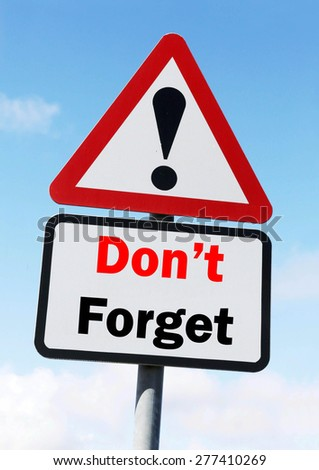 Red and White triangular warning road sign with a Don't Forget concept against a partly cloudy sky background. - stock photo