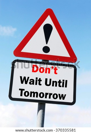 Red and White triangular warning road sign with a Don't Wait Until Tomorrow concept against a partly cloudy sky background. - stock photo