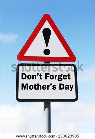 Red and white triangular warning road sign with a warning  not to forget Mother's Day ahead concept against a partly cloudy sky background - stock photo