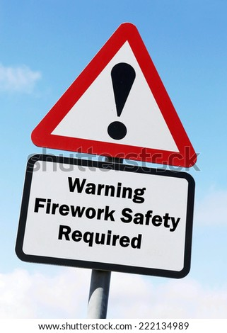 Red and white triangular warning road sign with a warning of Firework Safety Required concept against a partly cloudy sky background - stock photo