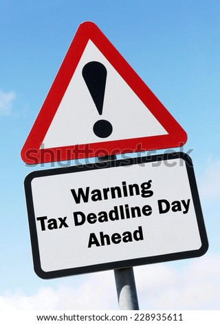 Red and white triangular warning road sign with a warning of the tax deadline day ahead concept against a partly cloudy sky background - stock photo