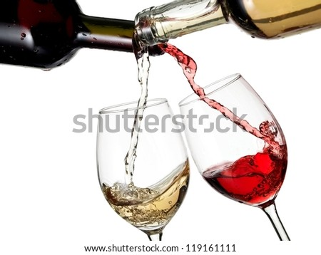 Red and white wine flow in two glasses - stock photo