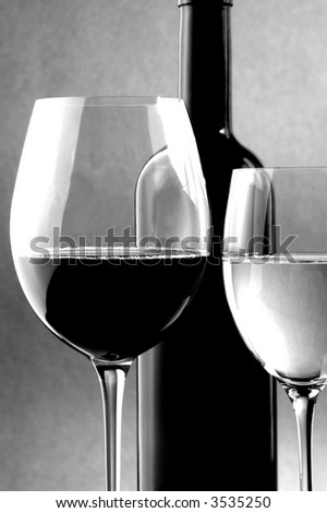 red and white wine glass and bottle
