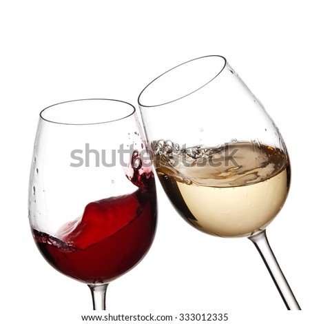 Red and white wine glasses plash, close up - stock photo
