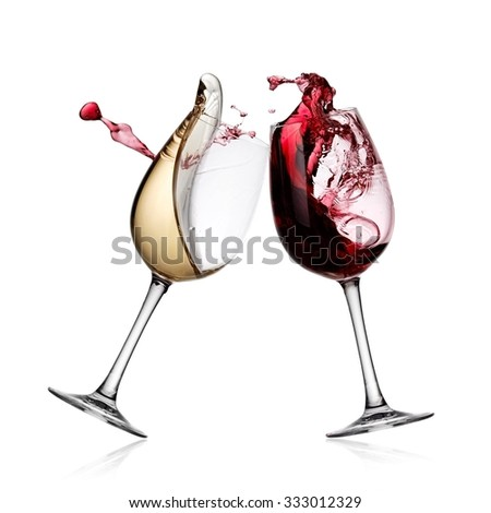 Red and white wine glasses up - stock photo