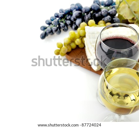 Red And White Wine Glasses with Cheese And Grape - stock photo