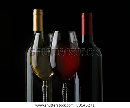 red and white wine on black