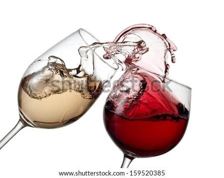 Red and white wine plash - stock photo