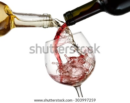 Red and white wine pour in a glass - stock photo