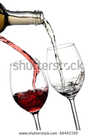 Red and white wine pouring into two glasses