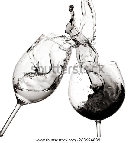 Red and white wine splash, black and white - stock photo