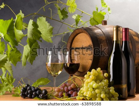 Red and White wine with grapes and a wine barrel - stock photo