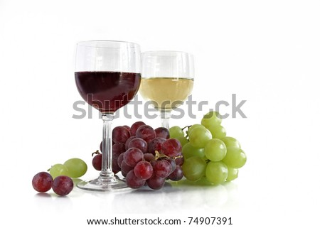red and white wine with red and white grapes - stock photo
