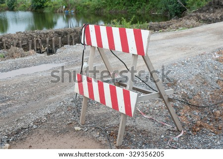 red and white worning sign at construction site - stock photo