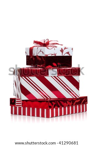 Red and white wrapped Christmas present on a white background with copy space - stock photo