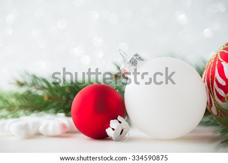 Red and white xmas ornaments on glitter holiday background. Merry christmas card. Winter theme. Happy New Year.  - stock photo