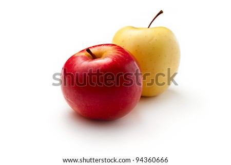 Red and yellow apples on white