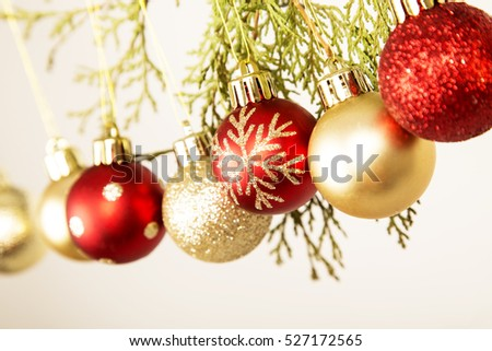 red and yellow baubles , christmas decorations ,december, red , glitter, white background ,winter ,ornaments ,pin ,leaves.